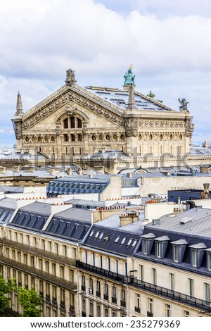 Panorama of Paris - Opera Garnier in the background. Palais Garnier is a 1,979 seat opera house, which was built in 1875 for Paris Opera. View from Printemps store. France. - stock photo