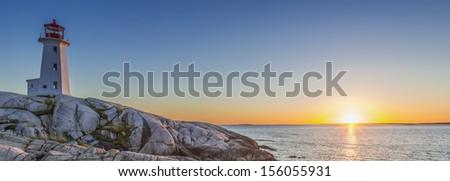 Panorama of Peggys Cove's Lighthouse at Sunset (Nova Scotia, Canada) - stock photo