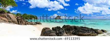 Panorama of perfect white sand beach in Seychelles - stock photo