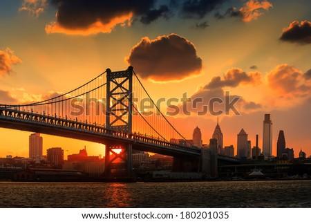 Panorama of Philadelphia skyline, Ben Franklin Bridge and Penn's Landing sunset - stock photo