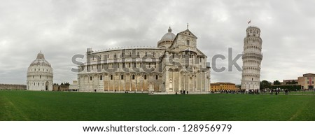 Panorama of Piazza dei Miracoli containing the Leaning Tower of Pisa, the Cathedral and Duomo - stock photo