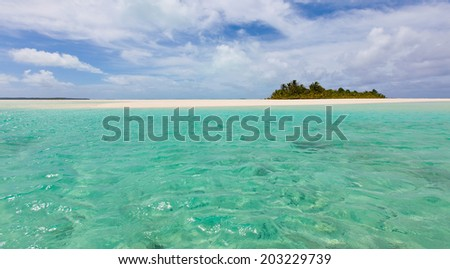 panorama of picture perfect island and breathtaking turquoise lagoon at cook islands, aitutaki - stock photo