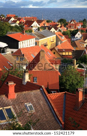 Panorama of picturesque small town Gudhjem with red roofs by early morning, Bornholm Island, Denmark - stock photo