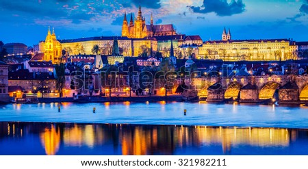 Panorama of Prague Castle and St. Vitus cathedral in twilight with dramatic sky. Prague, Czech Republic - stock photo