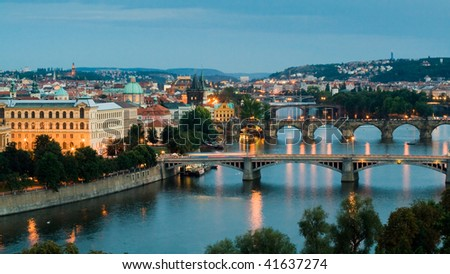 Panorama of Prague (Czech Republic) on sunset. Bridges of the Vltava River