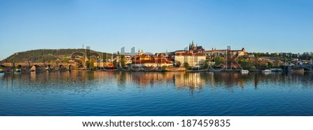 Panorama of Prague: Gradchany (Prague Castle), St. Vitus Cathedral and Charles Bridge over Vltava river on sunset, Prague, Czech Republic - stock photo