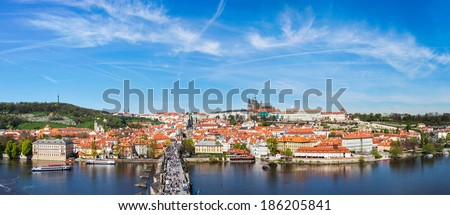 Panorama of Prague: Mala Strana,  Charles bridge and Prague castle from Old Town bridge tower over Vltava river. Prague, Czech Republic - stock photo