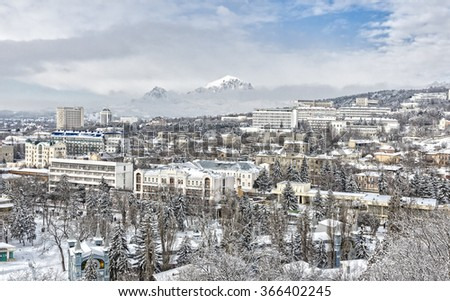 Panorama of Pyatigorsk city covered with snow. Against the backdrop of the mountains.