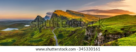 Panorama of  Quiraing mountains sunset at Isle of Skye, Scottish highlands, United Kingdom - stock photo