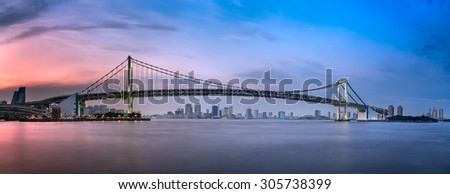 Panorama of Rainbow Bridge and Tokyo Skyline at Sunset, Tokyo, Japan - stock photo