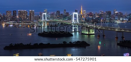 Panorama of Rainbow Bridge at night, Tokyo, Japan