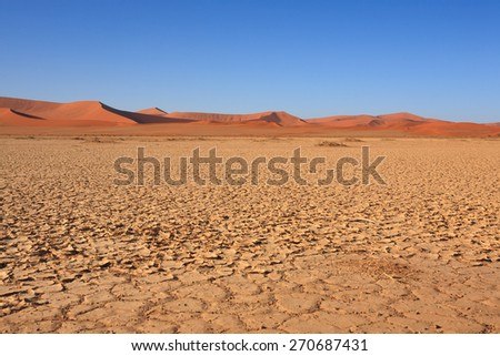 Panorama of red dunes from Sossusvlei Namibia - stock photo
