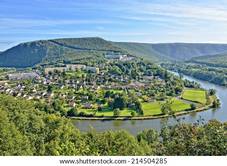 Panorama of Revin, a small town on river Meuse in Champagne-Ardenne, France under morning sun - stock photo