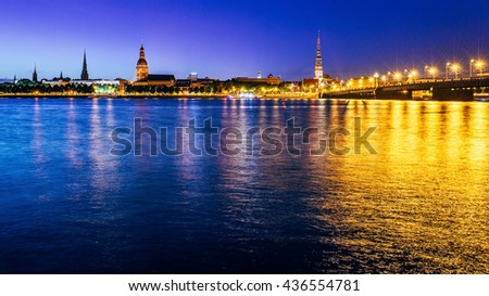 Panorama of Riga with Daugava river at night. - stock photo