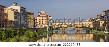 Panorama of river Arno and ponte Vecchio in Florence, Italy - stock photo