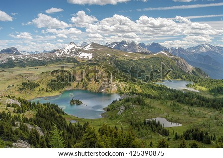 Panorama of Rock Isle Lake and Laryx Lake with Mt. Assiniboine in the distance from Standish Viewpoint in Sunshine Meadows, Mt. Assiniboine Provincial Park, British Columbia, Canada - stock photo