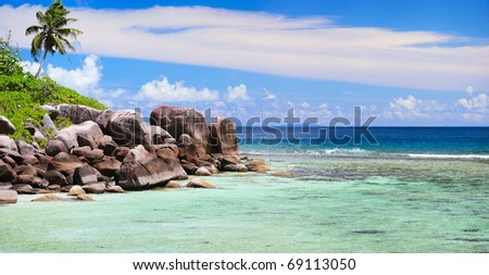 Panorama of  rocky coast and turquoise ocean waters in Seychelles