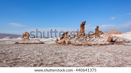 Panorama of salt sculptures, which are unique geological formations in a lifeless place called the moon Valley in Atacama Desert - Chile, South America - stock photo