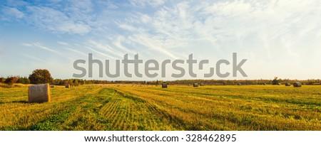 Panorama of scenic view of hay stacks at fall (North Cape Coastal Drive, Prince Edward Island, Canada) - stock photo