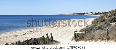 Panorama of scenic views of  four wheel drive access to   pristine Binningup Beach Western Australia on a sunny afternoon in late  summer highlight the peaceful Indian Ocean lapping the sandy shore. - stock photo