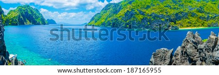 Panorama of sea gulf with rocky shore, Philippines - stock photo