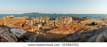 Panorama of seascape and rock field foreground photo - stock photo