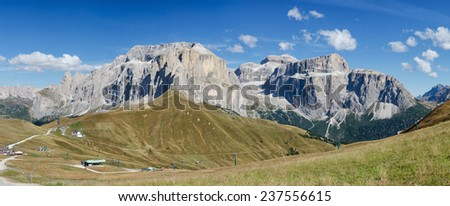 Panorama of Sella mountains with paragliders, South Tyrol, Italy