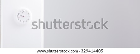 Panorama of simple white clock in corporation office - stock photo