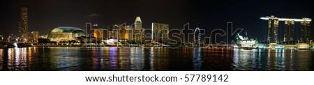 Panorama of Singapore city skyline at night - stock photo