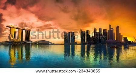 Panorama of Singapore city skyline at sunset - stock photo