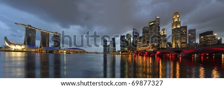 Panorama of Singapore river and skyline at blue hour - stock photo