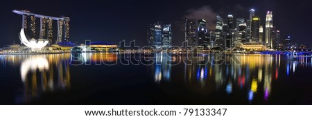 Panorama of Singapore river and skyline at night - stock photo