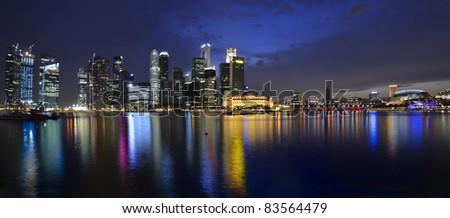 Panorama of Singapore river and skyline at night - stock photo