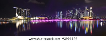 Panorama of Singapore skyline and river at night - stock photo