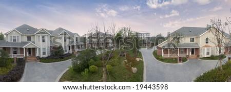 Panorama of single story bungalows - stock photo