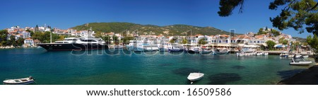 Panorama of Skiathos Town harbor on Skiathos Island, part of Sporades Archipelago, in Greece, Europe, taken from the Bourtzi center on a sunny summer day - stock photo