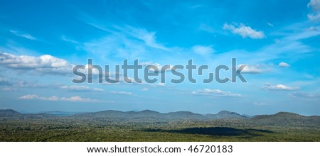 Panorama of sky and hills covered with trees. Good for banners. - stock photo