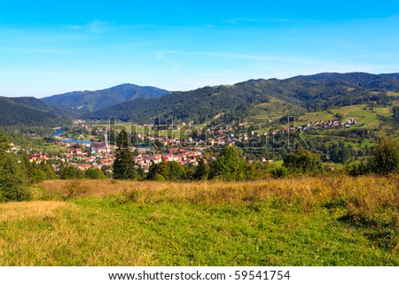 Panorama of small mountain town in polish carpathians. - stock photo