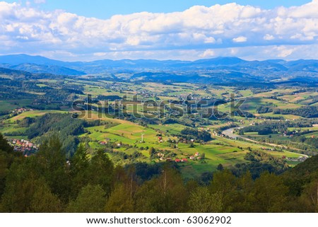 Panorama of small mountain towns in a valley - stock photo