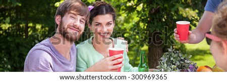 Panorama of smiling couple enjoying holidays during barbecue - stock photo