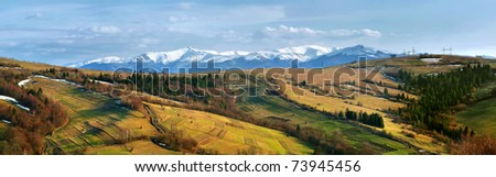 Panorama of snow-capped peaks of Carpathian Mountains - stock photo
