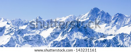 Panorama of Snow Mountain Range  Blue Sky from Titlis Peak, Switzerland