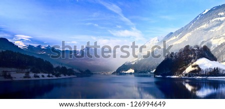 Panorama of Snow Mountain. Winter in the swiss alps. - stock photo