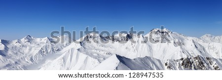 Panorama of snowy mountains. Caucasus Mountains, Georgia, view from ski resort Gudauri. - stock photo