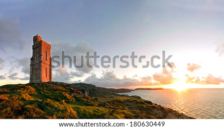 Panorama of South of the Isle of Man with Milner Tower. Brada Head on the Right and Calf of Mann on the left. Tranquil scene during sunset - stock photo
