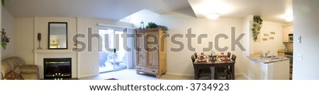 Panorama of staged living room - stock photo