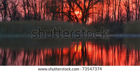 Panorama of sunset at the lake - stock photo