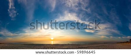 Panorama of sunset seacoast. Sand and waves - stock photo