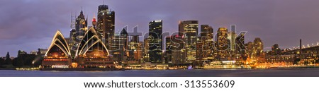 Panorama of SYdney City CBD from Kiribilli across Sydney Harbour at sunrise when downtown is brightly illuminated