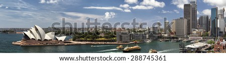 Panorama of Sydney Cove and the Harbour of Sydney, Australia, view on the Skyline of Sydney and the Sydney Opera House. Seen from the Sydney Harbour Bridge. - stock photo